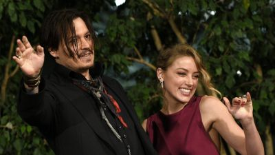 epa04588675 US actor/cast member Johnny Depp (L) and partner US actress Amber Heard (R) wave to fans as they leave the premiere of 'Mortdecai' in Tokyo, Japan, 27 January 2015. The movie will be released in Japanese theaters on 06 February.  EPA
