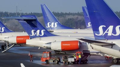 epa03531021 (FILE) A file photo dated 03 February 2009 showing Scandinavian airline SAS MD-80 and Boeing 737 aircrafts parked at the gates at terminal 4 at Arlanda Airport north of Stockholm, Sweden. Union representatives at troubled Scandinavian carrier