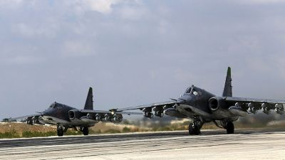 epa04966937 A handout picture dated 04 October 2015 made available on the official website of the Russian Defence Ministry on 06 October 2015 shows two Russian SU-25  strike fighters taking off from the Syrian Hmeymim airbase, outside Latakia, Syria.