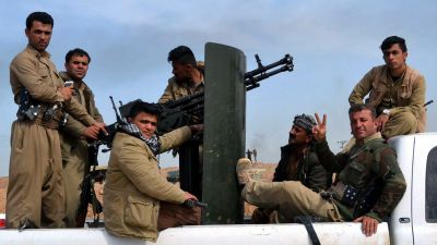 epa04655915 Kurdish Peshmerga soldiers pose as they take up position in a town west of Kirkuk city, northern Iraq, 09 March 2015. Kurdish forces have recaptured two towns in south and west of Kirkuk city from the Islamic State militia. Iraqi troops backed
