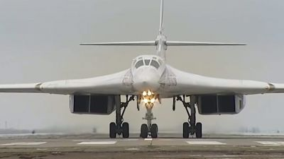 epa05033162 A handout frame grab from video footage released by the Russian Defence Ministry on 19 November 2015 shows a Russian Tu-160 long-range strategic bomber landing at an airbase deployed in Russia after its mission in Syria, 19 November 2015.