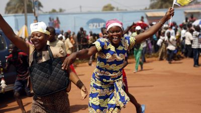 People cheer at Pope Francis upon his arrival in Bangui, Central African Republic, Sunday, Nov. 29, 2015. The Pope has landed in the capital of Central African Republic, his final stop in Africa and where he will seek to heal a country wracked by conflict