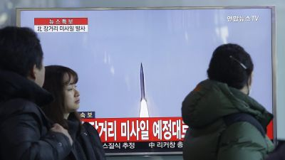 South Koreans watch a TV news program with a file footage about North Korea's rocket launch at Seoul Railway Station in Seoul, South Korea, Sunday, Feb. 7, 2016. North Korea on Sunday defied international warnings and launched a long-range rocket