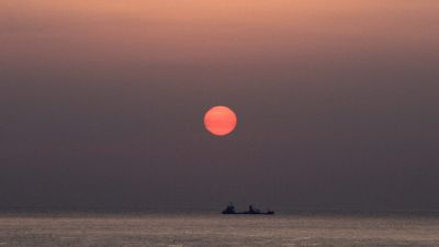 epa03789390 (22/22) A fishing vessel heads out to sea as the sun rises on South Korea's east coast near Ulsan, South Korea, 22 March 2013. Consumption of fish, seaweed and other products are part of Korea's culinary culture. The collection,