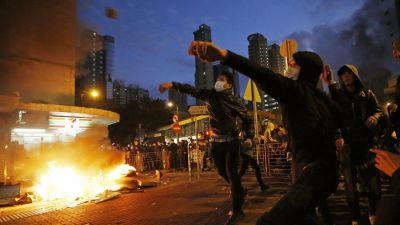 Rioters throw bricks at police and lit fires on streets in Mongkok district of Hong Kong, Tuesday, Feb. 9, 2016. Rioters clashed with police overnight and into the early hours of Tuesday in a crowded area of Kowloon. The unrest started when local