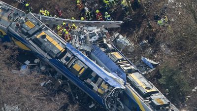 epa05151009 An aerial view of rescue forces working at the site of a train accident near Bad Aibling,Germany, 09 February 2016. At least eight people are dead and another 90 injured after two commuter trains collided head on near the southern German town