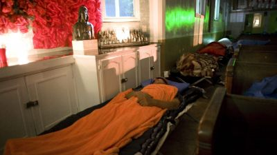 epa04534098 A picture made available on 18 December 2014 shows Homeless men, sleep in the Mission Dolores church in Los Angeles, California, USA, on 17 December 2014. For 26 years the church has run a homeless shelter called the Guadalupanos Homeless
