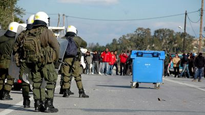 epaselect epa05146943 Riot police clash with residents in Pylio outside a military camp, where Greek authorities are preparing to establish a refugee hot spot, in island of Kos, Greece, 06 February 2016. According to local media, residents in Pylio have