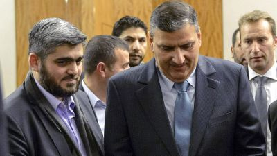 epa05141945 Chief negotiator for the main Syrian opposition body and rebel group Army of Islam, Mohammed Alloush (L) and Syrian opposition chief Riad Hijab (R)  leave after the press conference of Syrian peace talks at the President Wilson hotel in Geneva