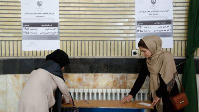 epa05282660 Iranian women fill their ballot to vote in a polling station during the second round of parliamentary elections at the Jameh Mosque in the city of Shahre Ghods, Iran, 29 April 2016. Polling stations opened in Iran on 29 April for the second