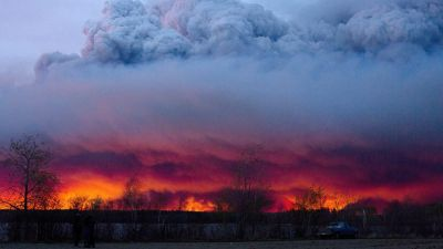A wildfire moves towards the town of Anzac from Fort McMurray, Alberta., on Wednesday May 4, 2016. Alberta declared a state of emergency Wednesday as crews frantically held back wind-whipped wildfires. Unseasonably hot temperatures combined with dry