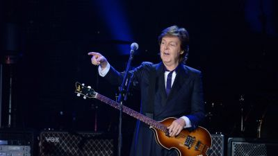 epa03755876 British musician and former Beatle, Paul McCartney performs during a concert at the National Stadium in Warsaw, Poland, 22 June 2013, as a part of his new tour 'Out There!'.  EPA/JACEK TURCZYK POLAND OUT