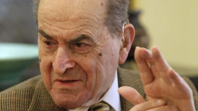 FILE - In this Feb. 5, 2014 file photo, Dr. Henry Heimlich describes the maneuver he developed to help clear obstructions from the windpipes of choking victims, while being interviewed at his home in Cincinnati.  Heimlich  recently used the emergency