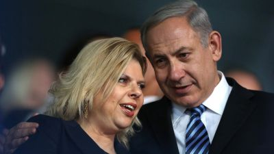 epa03792505 Israeli Prime Minister Benjamin Netanyahu (R) and his wife Sara Netanyahu (L) attend the opening ceremony of the Maccabiah Games in Ramat Gan, Israel, 18 July 2013. The 19th Maccabiah Games, dubbed the 'Jewish Olympics', will start