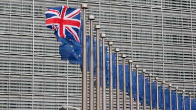 epa05133258 A Union Jack flag flutters next to European Union flags ahead a visits of the British Prime Minister David Cameron at the European Commission in Brussels, Belgium, 29 January 2016. Cameron arived in Brussels for unscheduled talks on a Brexit
