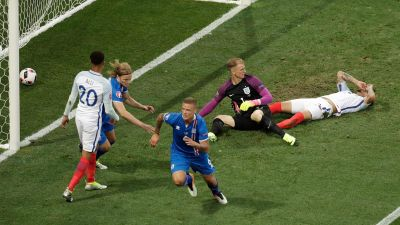 Iceland's Ragnar Sigurdsson, center, celebrates after scoring during the Euro 2016 round of 16 soccer match between England and Iceland, at the Allianz Riviera stadium in Nice, France, Monday, June 27, 2016. (AP Photo/Ariel Schalit)