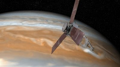 epa05370574 An undated handout image made available by NASA on 16 June 2016 shows an artist's rendering of NASA's Juno spacecraft making one of its close passes over Jupiter. According to NASA, ON 04 July 2016 NASA will fly a solar-powered