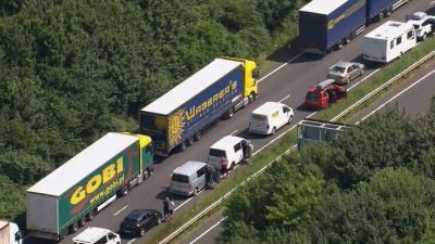 In this aerial view taken from video, part of the miles long queue of traffic outside Dover, England, waiting to cross the English Channel into France, Saturday July 23, 2016, as France is under a state of emergency.  Heightened French border security
