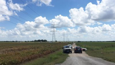 Police cars block access to the site where a hot air balloon crashed early Saturday, July 30, 2016, near Lockhart, Texas.  At least 16 people were on board the balloon, which Federal Aviation Administration spokesman Lynn Lunsford said caught fire before