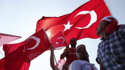 epa05461183 People wave Turkish flags during a rally to protest the failed coup attempt at 15th July 2016 and mourn the 240 killed people including civilians, policemen, and soldiers, 07 August 2016, Istanbul. Thousands of people attend a massive