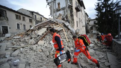 Rescuers search a crumbled building in Arcuata del Tronto, central Italy, where a 6.1 earthquake struck just after 3:30 a.m., Wednesday, Aug. 24, 2016. The quake was felt across a broad section of central Italy, including the capital Rome where people in