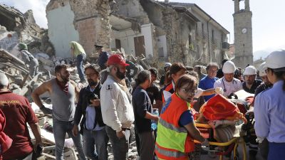 A victim is pulled out of the rubble following an earthquake in Amatrice Italy, Wednesday, Aug. 24, 2016.  The magnitude 6 quake struck at 3:36 a.m. (0136 GMT) and was felt across a broad swath of central Italy, including Rome where residents of the