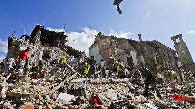 Rescuers search amid rubble following an earthquake in Amatrice Italy, Wednesday, Aug. 24, 2016. The magnitude 6 quake struck at 3:36 a.m. (0136 GMT) and was felt across a broad swath of central Italy, including Rome where residents of the capital felt a
