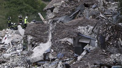 Rescuers search amid rubble of collapsed houses following an earthquake in Pescara Del Tronto, Italy, Wednesday, Aug. 24, 2016. The magnitude 6 quake struck at 3:36 a.m. (0136 GMT) and was felt across a broad swath of central Italy, including Rome where
