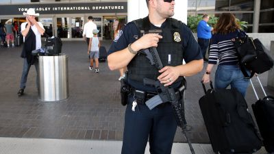 epa05513694 (FILE) A file photograph showing US Customs and Border officer stands guard outside the Bradley International Terminal at LAX Los Angeles Airport in Los Angeles, California,  USA, 01 July 2016.  Media reports on 29 August 2016 state that there