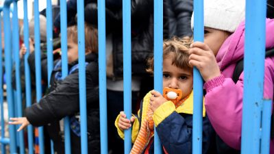 On 24 February 2016, a little girl waits in line at Vinojug transit center, near the town of Gevgelija, to board the train to the Serbian border. Refugees and migrants are crossing from Greece into the Vinojug Transit Center, near the town of Gevgelija.