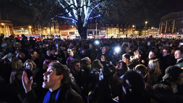 epa05097828 Thousands of Bowie fans turn out in Brixton, birth place of the late British musician David Bowie for a street party to honour Bowie in London, Britain, 11 January 2016. Well-wishers have flocked to the Brixton to pay their respects following