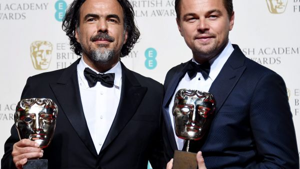 epa05161435 Alejandro Gonzalez Inarritu (L) and Leonardo DiCaprio (R) pose in the press room after winning the Best Director and Best Actor respectively for 'The Revenant' during the 69th annual British Academy Film Awards at the Royal Opera