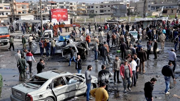 epa05173431 Syrian policemen and citizens inspect the site of a twin bomb attack in the city of Homs, Syria, 21 February 2015. The death toll from the double bomb attack in the Syrian city of Homs rose to 46, including at least 28 civilians, the Syrian