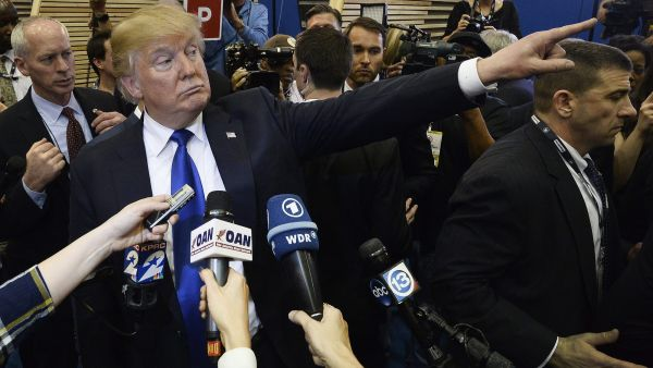 epaselect epa05181226 US Republican presidential candidate Donald Trump gestures as he talks to members of the media in the spin room after the CNN Republican Presidential Primary Debate at the University of Houston's Moores School of Music Opera