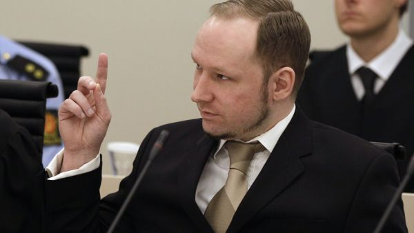 Norwegian Anders Behring Breivik gestures as he appears in court to face terrorism and premeditated murder charges, Oslo, Norway, Monday, April 16, 2012. Breivik, who confessed to killing 77 people in a bomb-and-shooting massacre went on trial in Norway&