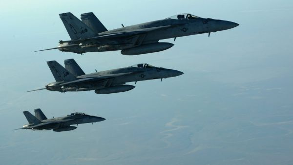 epa04416226 A handout picture made available by the US Department of Defense (DoD) on 25 September 2014 shows a formation of US Navy F-18E Super Hornets leaving after receiving fuel from a KC-135 Stratotanker over northern Iraq, 23 September 2014. These