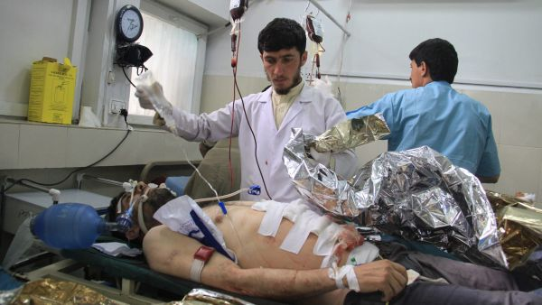 epa04709704 An Afghan man who was injured in a suicide bomb attack receives medical treatment at local hospital in Jalalabad, Afghanistan, 18 April 2015. A suicide bomber killed at least 30 people and injured 88 in a crowded area in eastern Afghanistan,