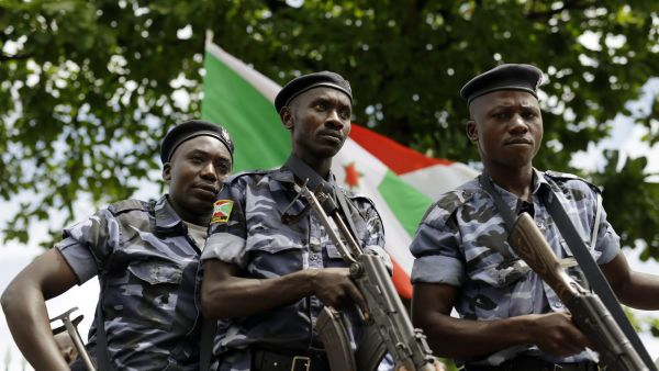 Members of President Pierre Nkurunziza's security detail lead his motorcade as the leaves the presidential palace after making a brief statement to the media at the presidential palace in Bujumbura, Burundi, Sunday May 17, 2015. This is the first