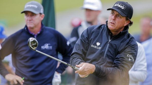 epa04803270 Phil Mickelson (R) of the US follows his tee shot on the first hole as Jimmy Walker (L) of the US looks on during practice for the 115th US Open Championship golf tournament at Chambers Bay in University Place, Washington, USA, 16 June 2015.