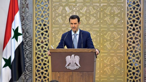 epa04861260 A handout photo released by Syria's Arab News Agency (SANA) shows Syrian President Bashar Assad delivering a speech during a meeting with heads and members of public organizations, vocational syndicates, and chambers of industry, trade,