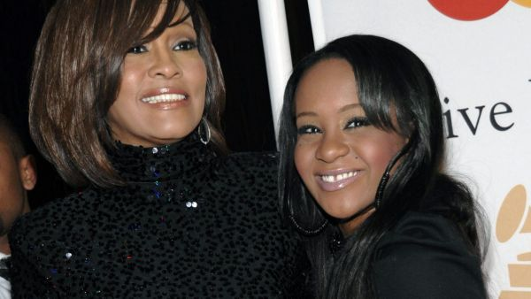 FILE - In this Feb. 12, 2011, file photo, singer Whitney Houston, left, and daughter Bobbi Kristina Brown arrive at an event in Beverly Hills, Calif. Brown, who was in hospice after months of receiving medical care, died on Sunday, July 26, 2015. (AP