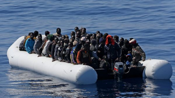 epa04717106 A picture made available on 23 April 2015 shows some of over 200 illegal migrants, before they are shipped to the Italian mainland after being rescued by Italian Guardia di Finanza boat 'Denaro' in the Mediterranean Sea, 22 April