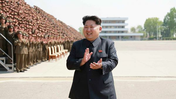 epa04727690 An undated picture released by the Rodong Sinmun, the newspaper of the North Korean ruling Workers Party, on 01 May 2015 shows North Korean leader Kim Jong-un applauding during a photo session with a group of training officers of the Korea