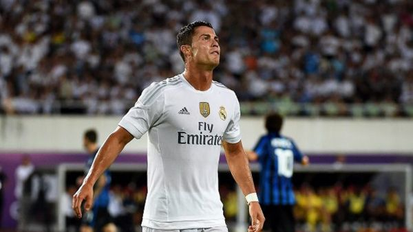 epa04862841 Real Madrid's Cristiano Ronaldo reacts during the friendly test soccer match between Real Madrid and Inter Milan in Guangzhou, China, 27 July 2015. Real Madrid won 3-0.  EPA/XI YA CHINA OUT