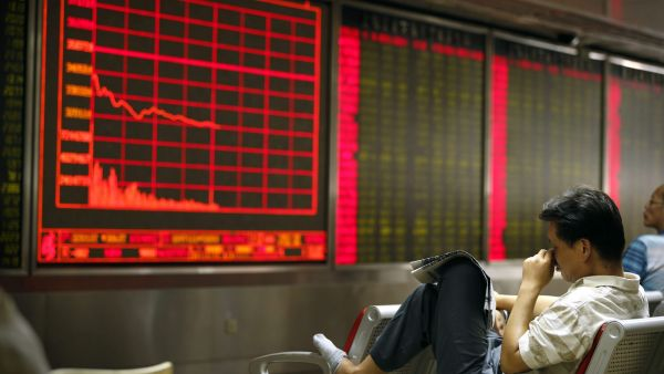 A Chinese investor monitors stock prices at at a brokerage house in Beijing, Monday, Aug. 24, 2015. Stocks tumbled across Asia on Monday as investors shaken by the sell-off last week on Wall Street unloaded shares in practically every sector. (AP Photo