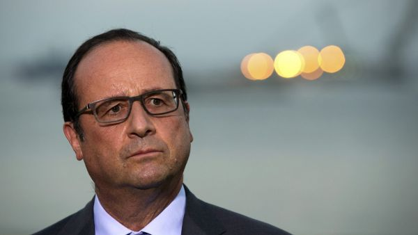 epa04874848 French President, Francois Hollande, speaks to journalists in front of the Suez of an addition to the Suez Canal, in Ismailia, Egypt, 06 August 2015. The latest addition to the canal comes in at 35 kilometers of new canal and the widening of a