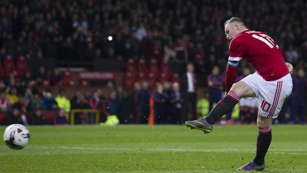 In this picture taken on Wednesday Oct. 28, 2015, Manchester United's Wayne Rooney takes a penalty during the English League Cup soccer match berween Manchester United and Middlesbrough at Old Trafford Stadium, Manchester, England. The Football