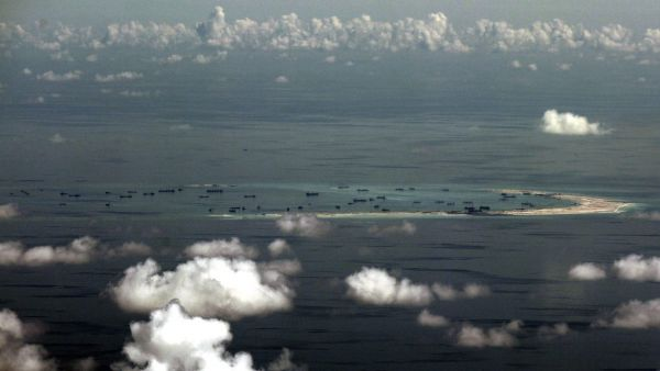 epa04998024 (FILE) A file picture dated 11 May 2015 shows an areal view of alleged artificial islands built by China in disputed waters in the South China Sea, west of Palawan, Philippines. A United States Navy warship entered disputed waters in the South