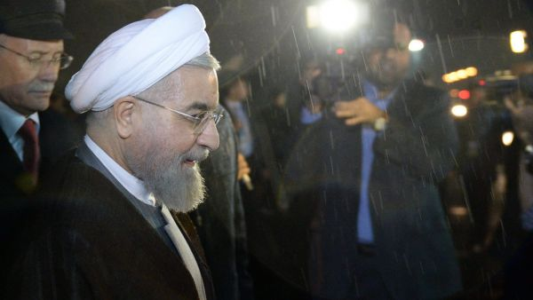 epa04838085 Iran's President Hassan Rouhani (L) attends a welcoming ceremony upon his arrival in Ufa, the capital of  Bashkortostan republic, Russia, 09 July 2015. Ufa is hosting BRICS (Brazil, Russia, India, China and South Africa) and SCO (Shanghai