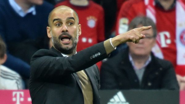 epa05015696 Munich's head coach Pep Guardiola gestures during the German Bundesliga soccer match between Bayern Munich and VfB Stuttgart in Munich, Germany, 07 November 2015.  EPA/ PETER KNEFFEL (EMBARGO CONDITIONS - ATTENTION - Due to the